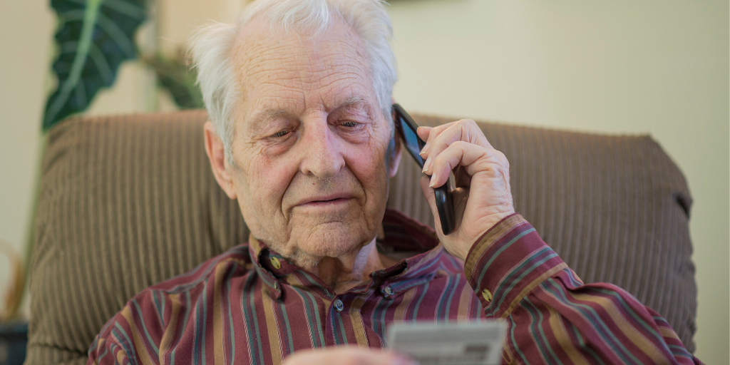 Elderly man telephone scam reading out his card details