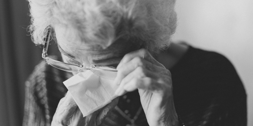 Old lady crying after being a victim of fraud