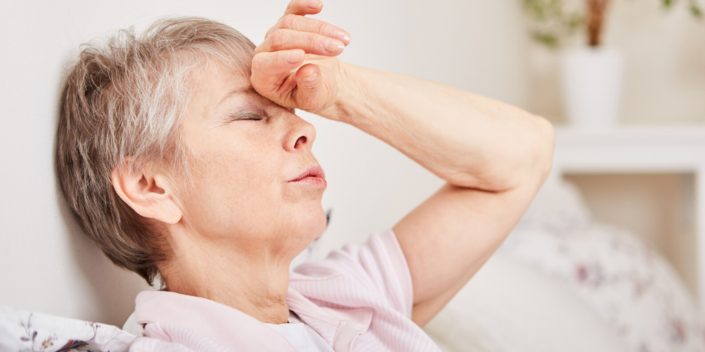 benefits of drinking water hydration in older adults lady sat down feeling faint