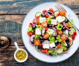 Delicious Summer Meal Ideas greek salad with a side serving of herb olive oil