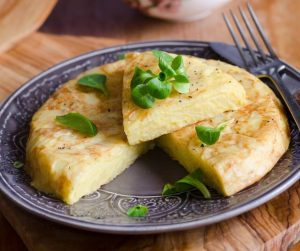 Delicious Summer Meal Ideas spanish omelette with herb garnish