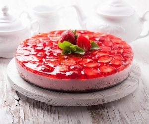 Delicious Summer Meal Ideas strawberry cheesecake with strawberries on top