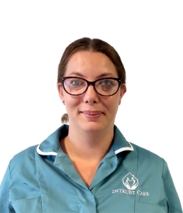 A picture of our care coordinator Sarah wearing her Intrust Care uniform